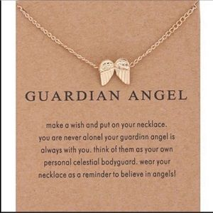 Jewelry - Guardian angel gold wing necklace on a gift card